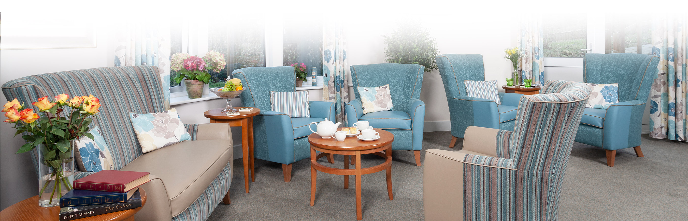 Lounge area with blue chairs at Cedar view care centre croydon
